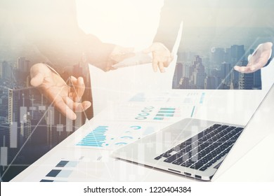 BUsiness Investment Advisory Team Analyzes Company's Annual financial statements. Balance Sheets Work with graph papers.Concept of internal Audit, TAX ,investment Analysis for Shareholders
