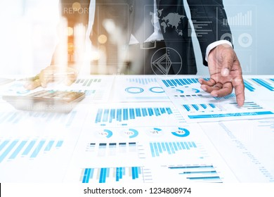 Business Investment Advisory Team Analyzes Company's Annual Financial statements. Balance Sheets Work with Graph papers. AUDIT tax Analysis concepst