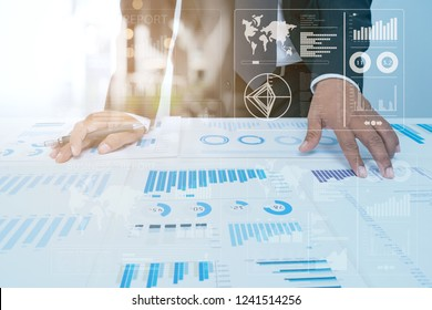 Business Investment Advisory Team Analyzes COmpany's Annual Financial Statements.Balance sheets work with graph papers .Concept of internal Audit tax return on Investment Analysis Shareholders and