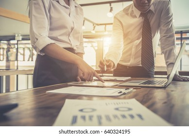 Business investment consultant team analyzing company annual financial report balance sheet statement working with documents graphs. Stock market, office, tax, education concept.