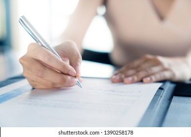 business investor woman success deal contract with paper sign close up hand hold pen sign contract