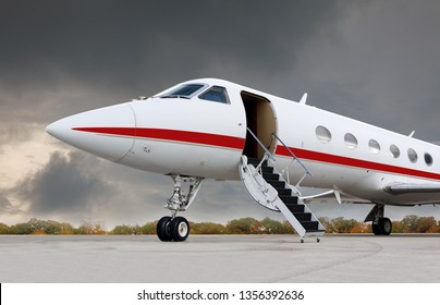 Business jet at the airport with the stairs down.