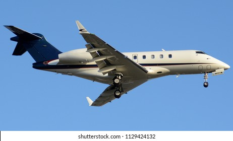 A Business Jet Flying with its Landing Gear Down