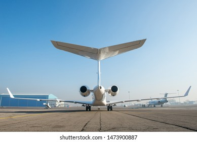 Business jet plane on the ground.