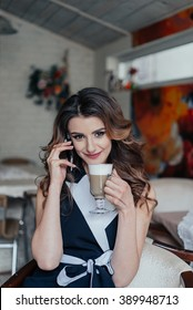 Business lady in cafe drinking latte