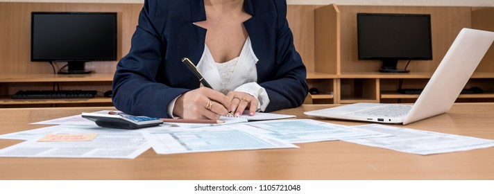business lady fills the 1040 tax form .