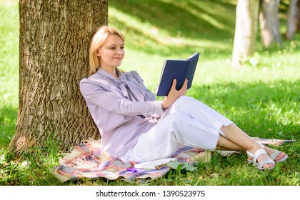 Business lady find minute to read book improve her knowledge. Female self improvement. Girl lean on tree while relax in park sit grass. Self improvement book. Self improvement and education concept.