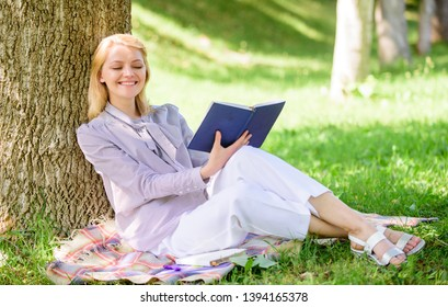 Business lady find minute to read book improve her knowledge. Self improvement and education concept. Female self improvement. Girl lean on tree while relax in park sit grass. Self improvement book.