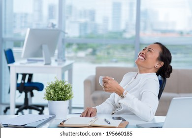 Business lady loudly laughing while having coffee break