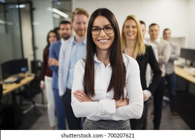 Business lady with positive look and cheerful smile posing for camera