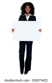 Business lady promoting big blank banner ad isolated on white