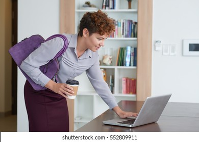 Business lady shutting down laptop before leaving the house
