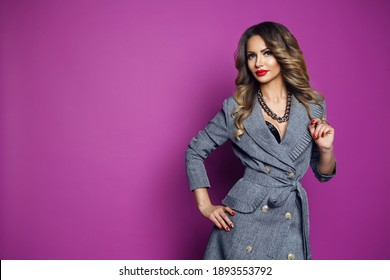 Business lady stands on the background. Elegant lady