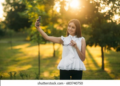 Business lady uses a tablet in the park during a break