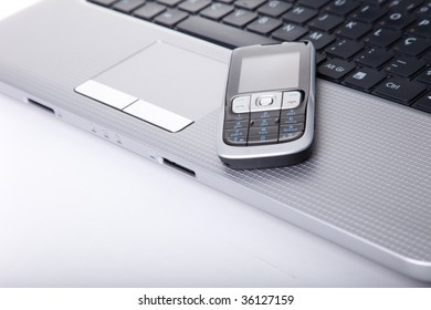 business laptop and cellphone at the office