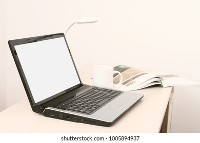 Business laptop on office desk. Free white space on screen.