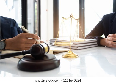 Business law concept, Lawyer business lawyers are consulting lawyers for women entrepreneurs to file a copyright lawsuit. Selective Focus