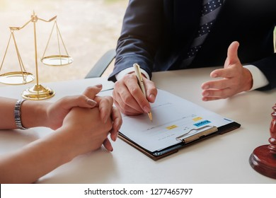 Business law concept, Lawyer business lawyers are consulting lawyers for women entrepreneurs to file a copyright lawsuit.
