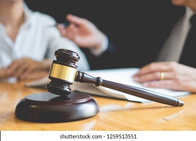 Business lawyer judge working about legal legislation Consultati