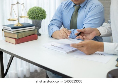 Business lawyer working about legal legislation in courtroom to help their customer.