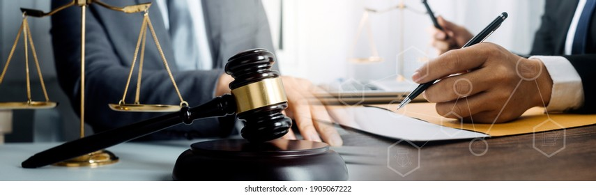 Business and lawyers discussing contract papers with brass scale on desk in office. Law, legal services, advice, justice and law concept