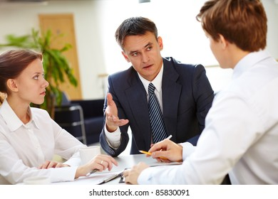 Business leader asking his employee about results