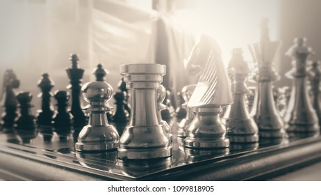 Business leader concept. Shot of a chess board ready to moving or fights against white enemy team on board. Selective focus and Black and white photography vintage tone.