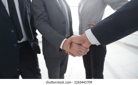 business leader shaking hands with the investor