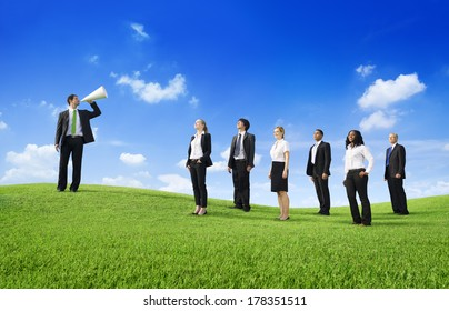 Business Leader Shouting at Team on a Green Hill