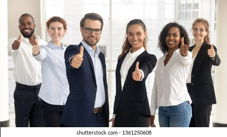 Business leaders with employees group showing thumbs up looking at camera, happy professional multicultural office team people recommend best corporate service, proud or good career, human resource
