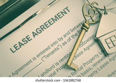 Business legal document concept : Pen and a keychain on lease agreement form. Lease agreement is a contract between a lessor and a lessee that allow lessee rights to use of a property owned by lessor.