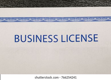Business license on a black desk macro shot
