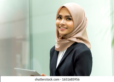 Business Lifestyle, Cute Malay Woman wearing hijab outdoor using tablet computer