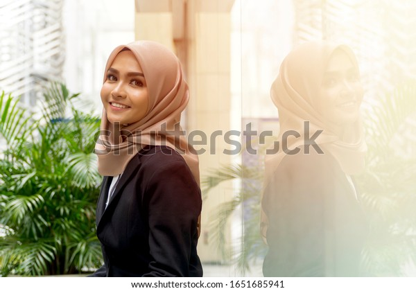 Business Lifestyle, Cute Malay Woman wearing hijab outdoor using laptop sitting on the bench