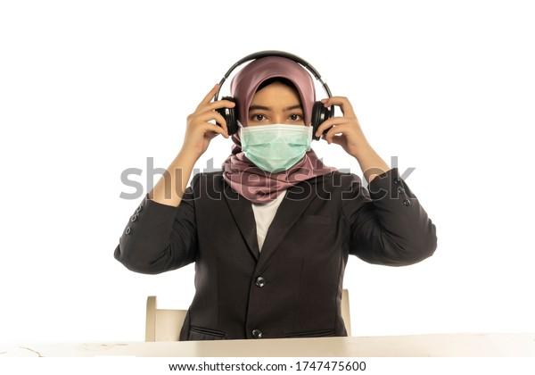 Business Lifestyle, Cute Malay Woman wearing hijab wearing facemask wearing headset