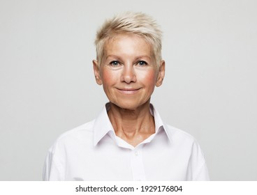 Business, lifestyle and old people concept: Portrait Of Happy Senior Businesswoman