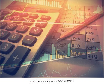 Business line and chart with calculator and pencil in vintage tone and light