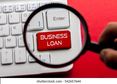 Business Loan word written on keyboard view with magnifier glass