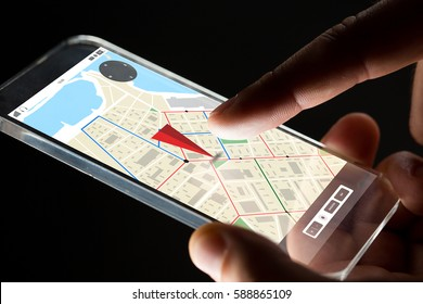 business, location, people and future technology concept - close up of businessman hand with transparent smartphone with gps navigator map on screen over black background