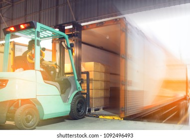 Business Logistic Concept, Forklift loading a pallet shipment into a truck container