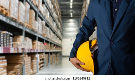 Business Logistics concept, Double exposure of engineer or worker hold yellow helmet for workers security with Modern Trade warehouse logistics