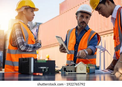 Business Logistics and concept, Foreman control loading Containers box of cargo freight ship for Logistic planning and meeting to build solar cell and explain  to team of diversity   worker