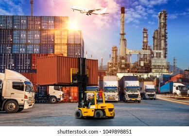 Business Logistics and transportation concept  of truck in Container yard  with Refinery oil and gas background at sunrise, logistic import export and transport industry background