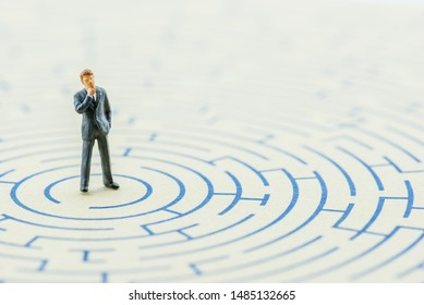 Business long-term decision, problem solving concept : Businessman thinks, find or searches for a way or direction to get out from hard situation, depicts complex strategy to escape from bad scenario
