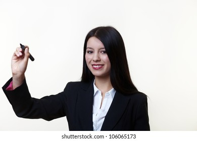 business looking woman writing in the air with a marker pen