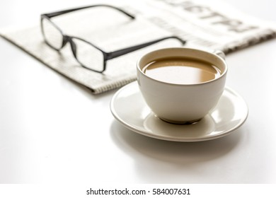 Business lunch with coffee and newspaper on white table top view