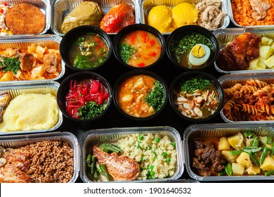 Business lunch in eco plastic container ready for delivery.Top view. Office Lunch boxes with food ready to go. Food takes away. Catering, brakfast