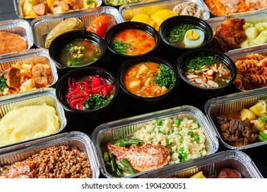 Business lunch in eco plastic container ready for delivery.Top view. Office Lunch boxes with food ready to go. Food takes away. Catering, breakfast