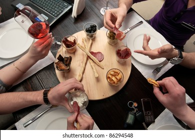 Business lunch - Group of people eating lunch of a set of delicious spicy snacks