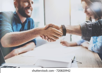Business male partnership handshake concept.Photo two mans handshaking process.Successful deal after great meeting.Horizontal, blurred background